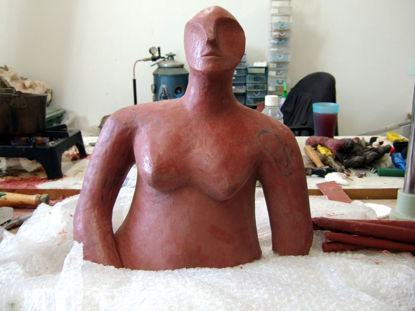 the wax sculpture is cut into several smaller piec