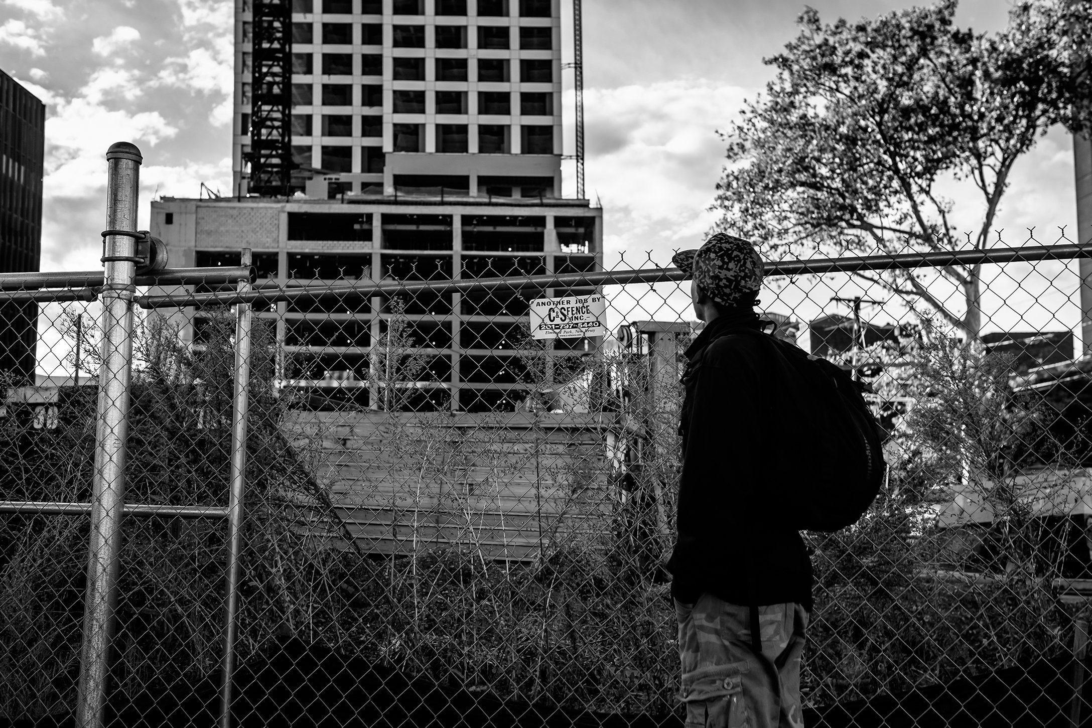 Man looks up at journal square condo construction.jpg