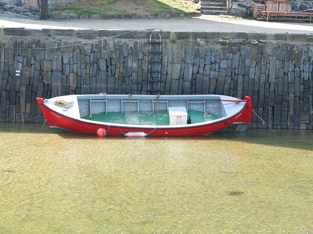 Red Rowing Boat in Harbour by Alison Gracie