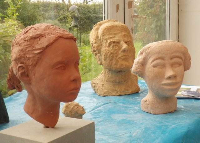 heads, and portarait (of daughter) , all by adult