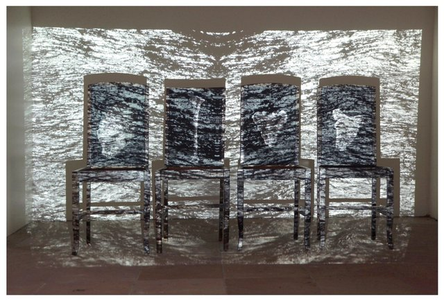 Days of Reckoning 2016 (still) sculptural component with projection - wooden chairs, photographs, projection.  2m x 2m x 50cm copy 2.jpg