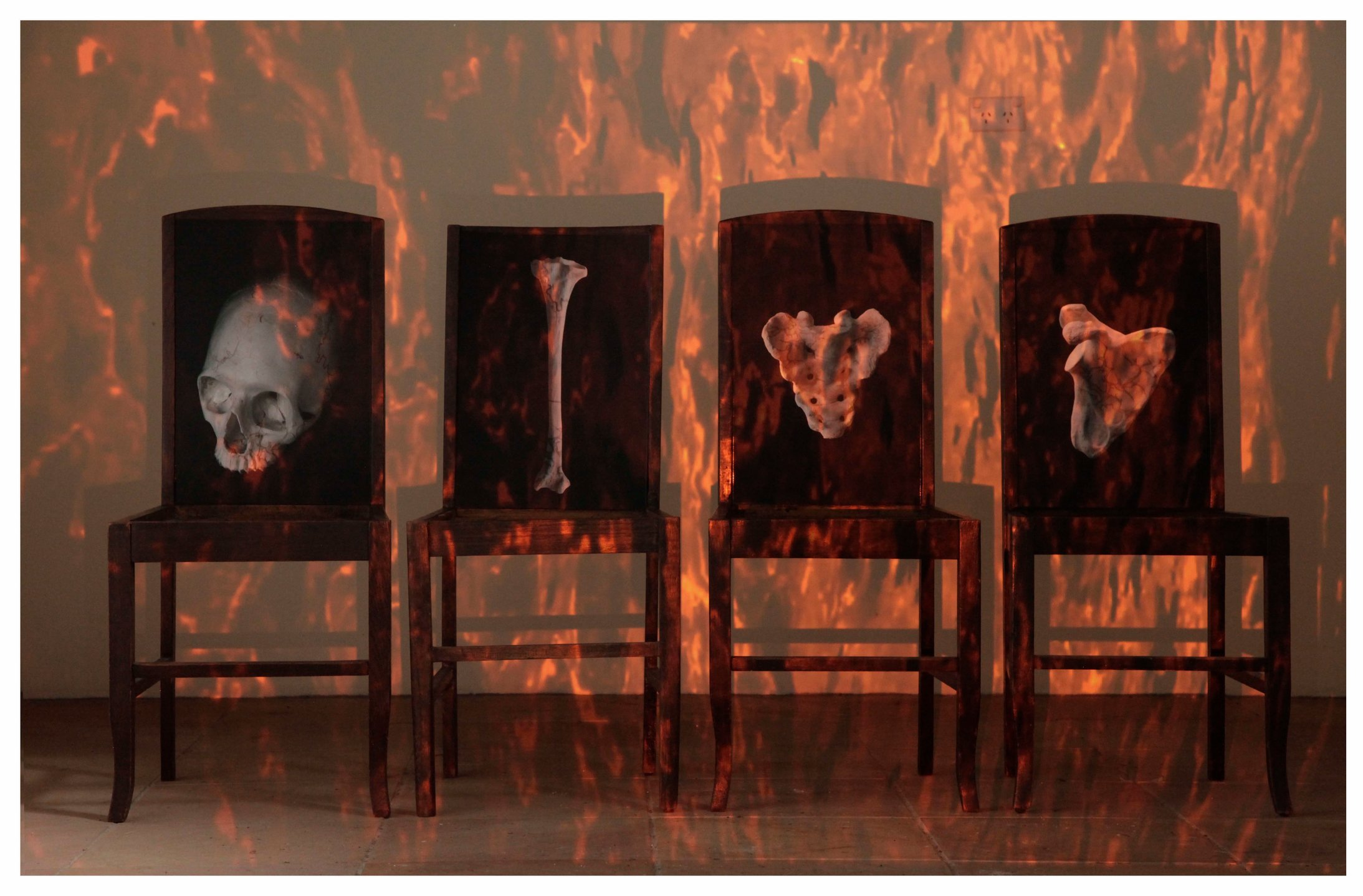 Jenny Pollak - Days of Reckoning 2016 (still) sculptural installation with projection - wooden chairs, photographs, projection .jpg