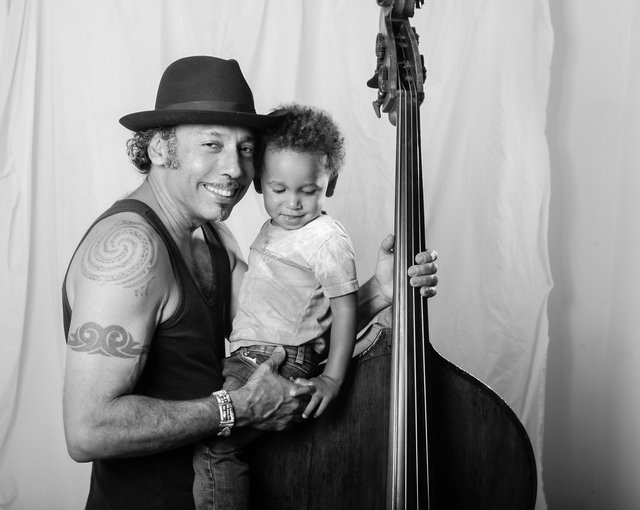 Musician Tony Garnier and son Tino