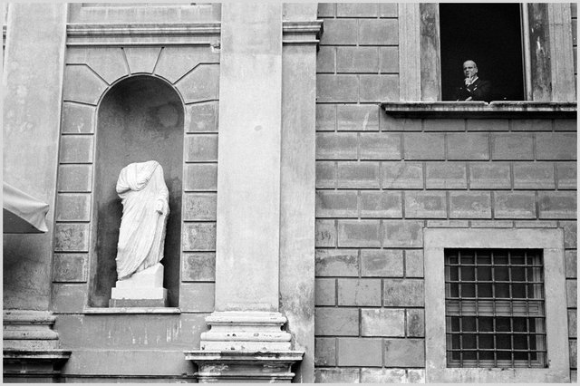 A vigilant at the Vatican City looking out the window. Rome, 2011