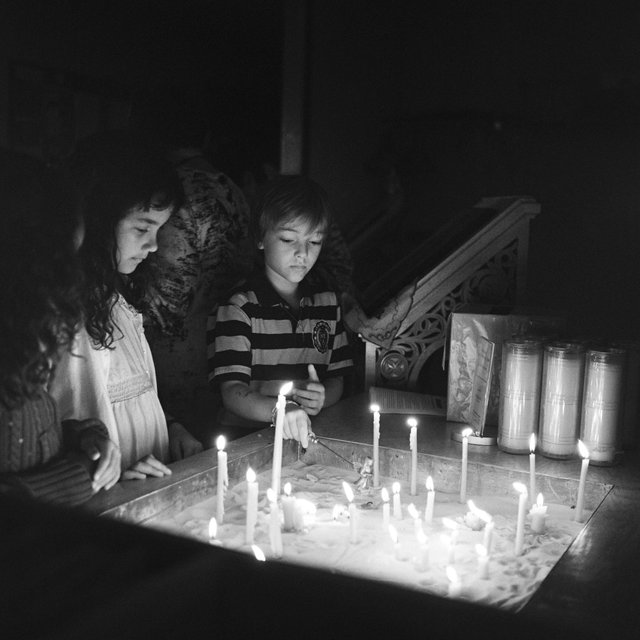 Children with Prayer Candles
