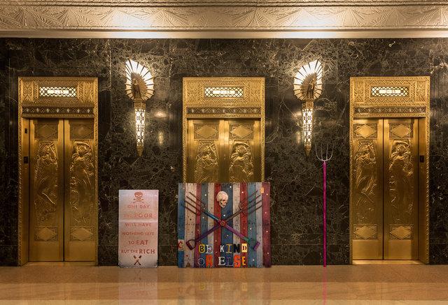 BE_KIND_SCULPTURE-GOLD-ELEVATOR_DOORS.jpg