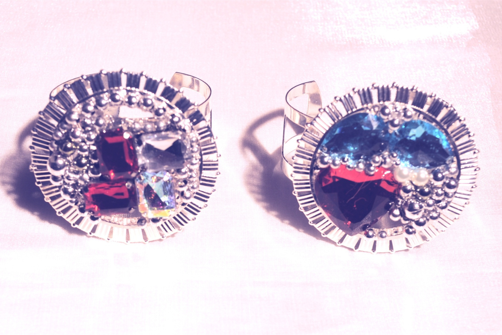 SILVER CUFFS with red, blue, and ab stones.