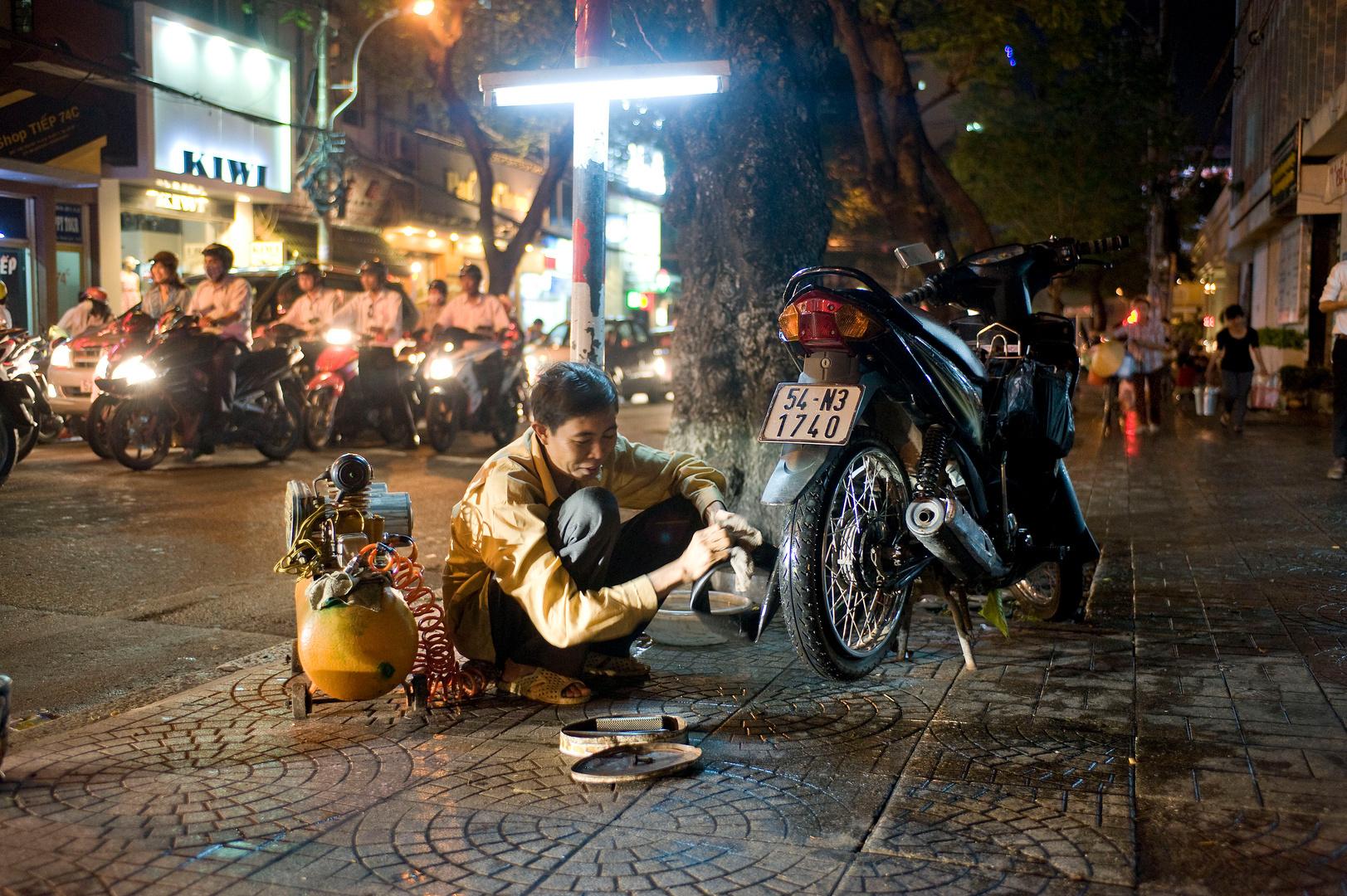 Bandenplakker, Ho Chi Minh City, Vietnam