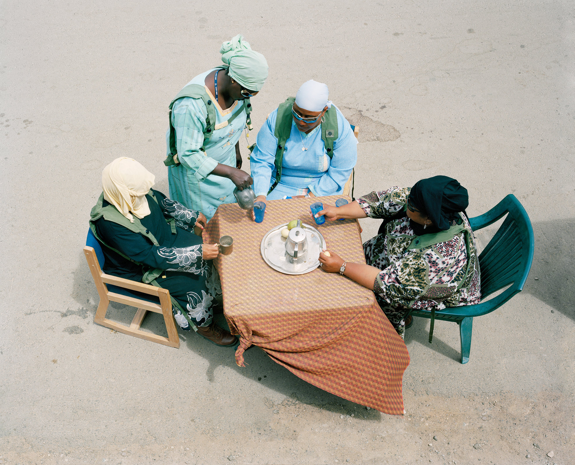 American civilians playing the role of Iraqi village women drinking tea, Medina Wasl Village, National Training Center, Fort Irwin, CA 2009