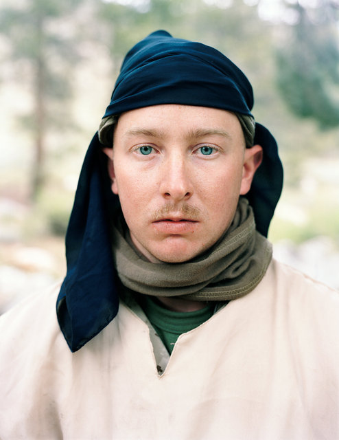 Marine Lance Corporal Joshua Stevens playing the role of a Taliban fighter, Landing Zone Owl, Marine Corps Mountain Warfare Training Center, CA, 2009