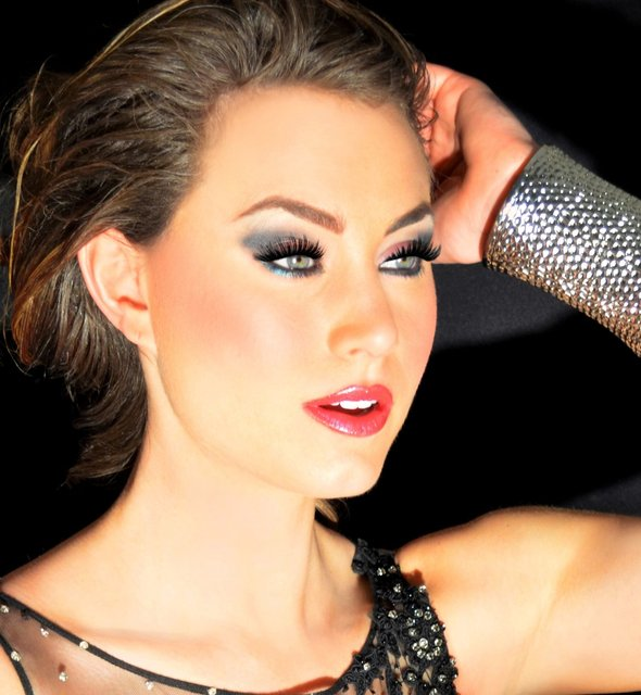 BROOKE WEARS PALE GRAY SHADOW, BLACK LINER, AND  PINK LIPS.