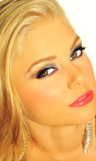 ALI WEARS ELEGANT IVORY, MAUVE AND BLACK LINER, WITH  PINK LIPS LOOKS GREAT ON ALI.
