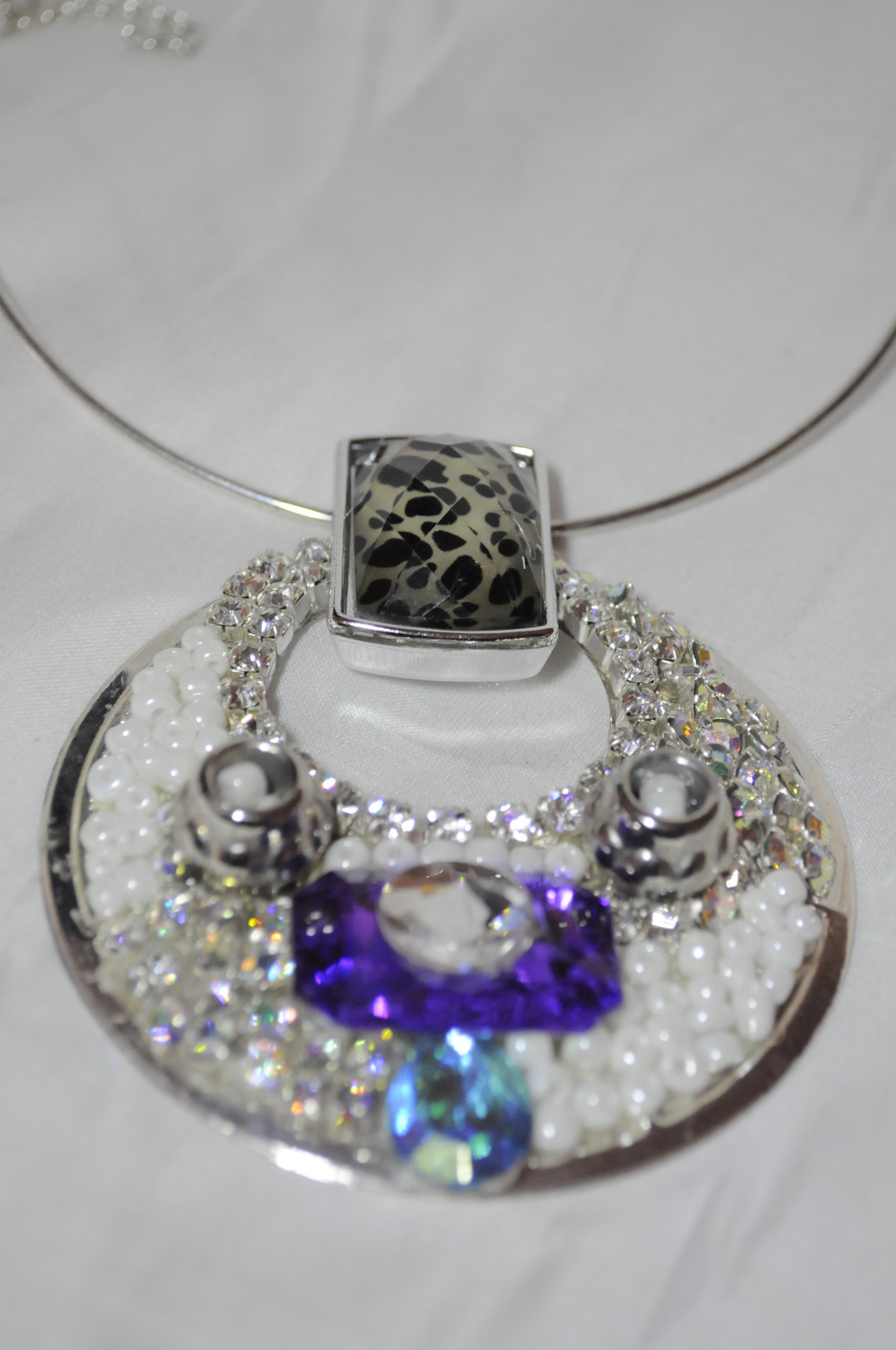 LARGE ROUND ART DECO necklace with silver attachments, pearls, and stones.