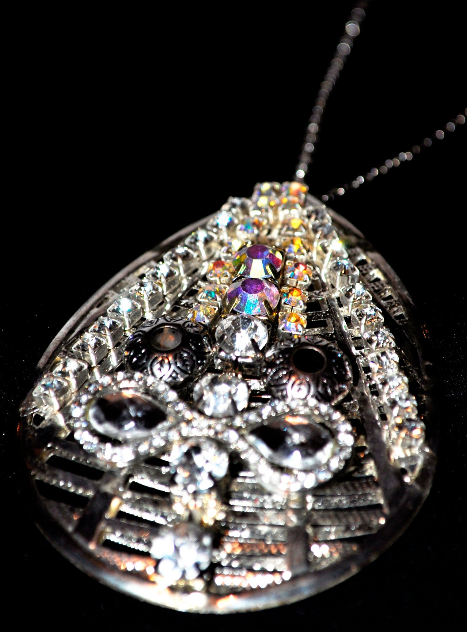 SILVER TEARDROP WITH AB CRYSTAL STONES