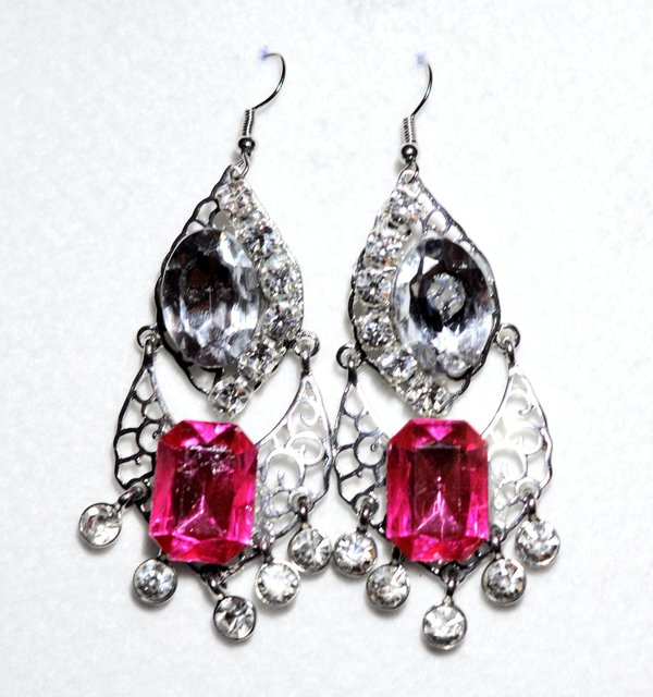 "2"" SILVER CRYSTAL earrings with pink stone."