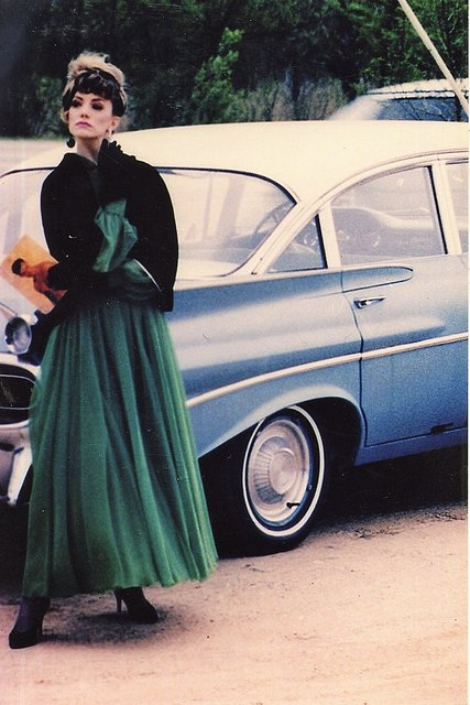 50'S CHEVY, EVENING GOWN, VELVET GLOVES, ALL ELEMENTS OF GOLDEN ERA STYLE.