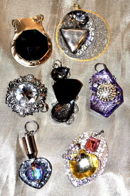 VARIETY OF NECKLACE PENDANTS.   They all come with chains.