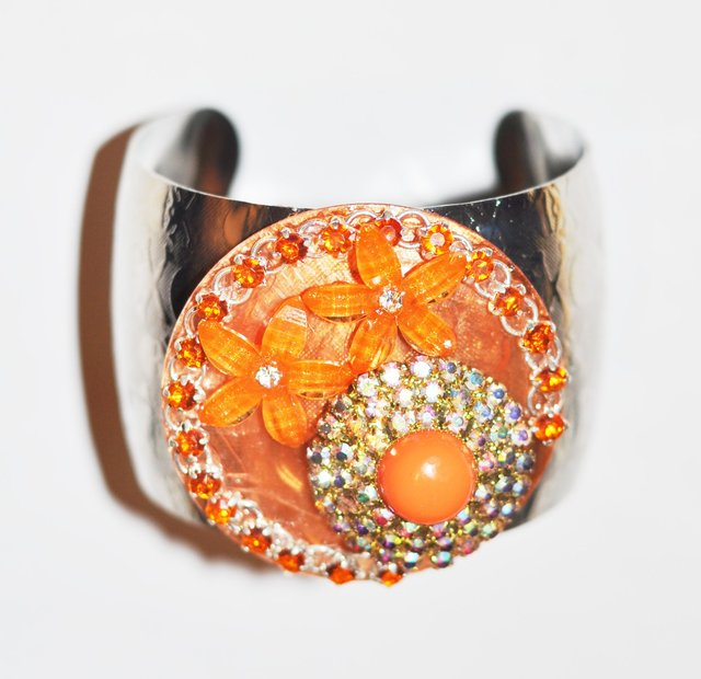 SILVER BRACELET WITH TANGERINE AND AB STONE EMBELLISHMENTS.