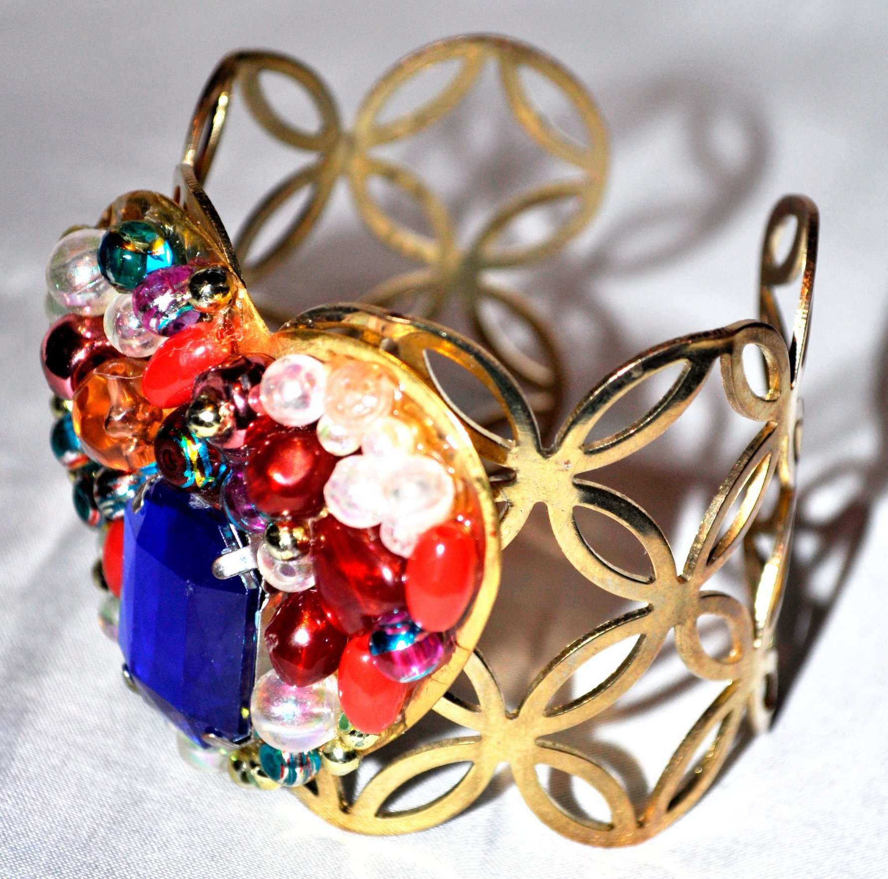 GOLD CUFF WITH BEADED HEART