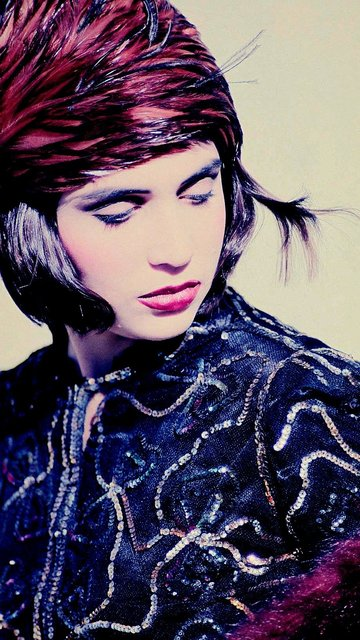 VINTAGE FEATHERS, FAUX FUR, LACE, SEQUINS MEANS AN EXPLOSION OF DRAMA.