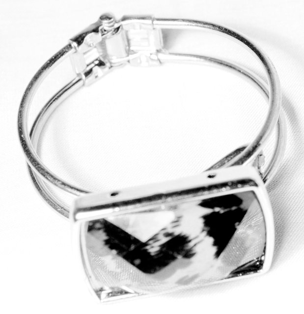 SILVER CUFF WITH ANIMAL PRINT PENDANT