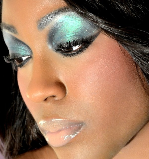 BIANCA LOOKS INNOCENT WITH CAPRI BLUE, AND DECACENT BLACK LINER WITH NUDE LIP COLOR.