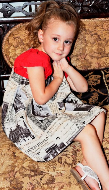 BRAELYN  MODELS A DRESS THAT COULD BE MADE FROM THE FRENCH NEWSPAPER.