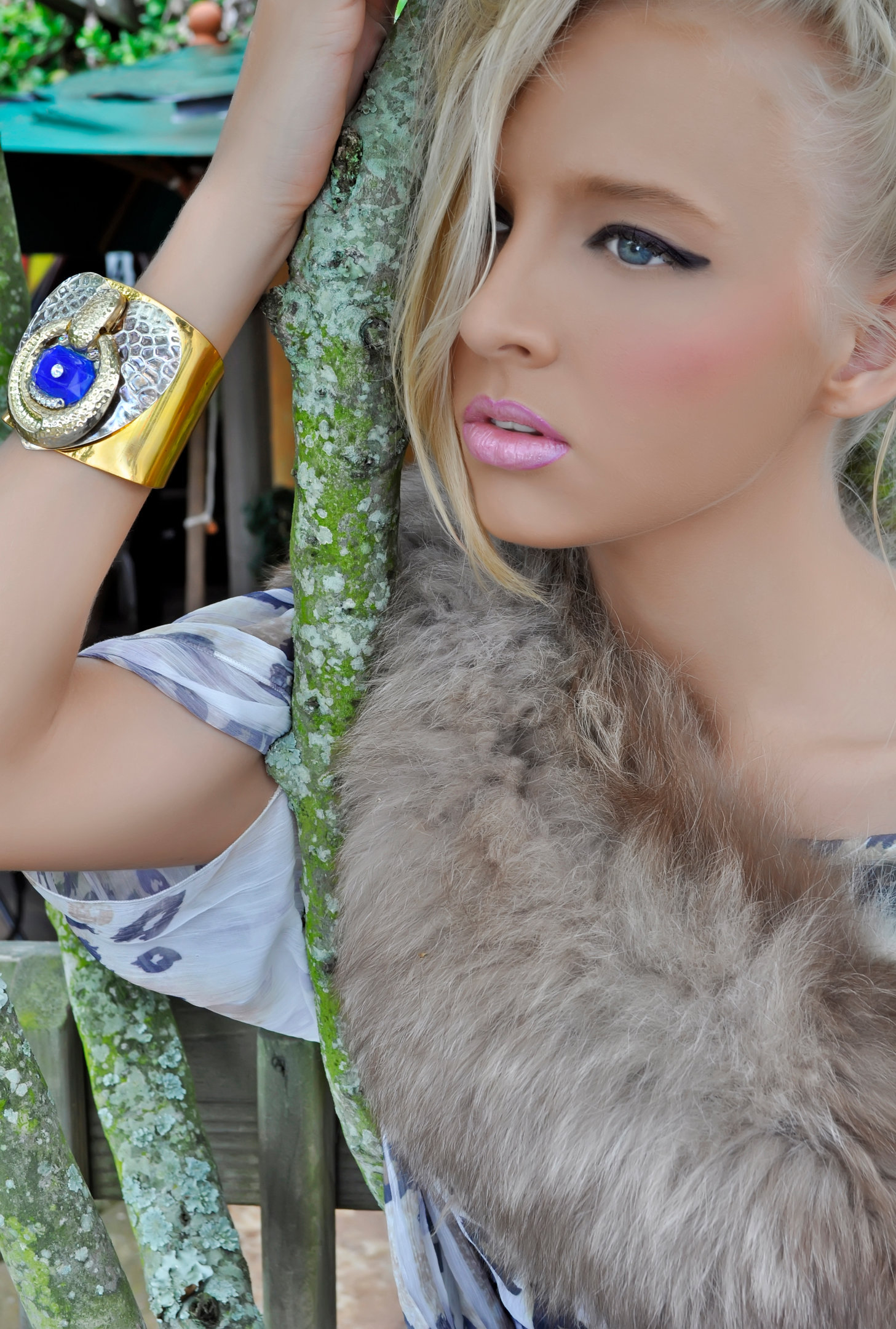 MISS NC COLLEGIATE AMERICA- Jessica Lucas is wearing a gold cuff with a blue stone and embellishments.