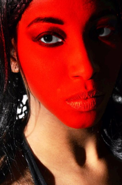 DAJA;S THEATRICAL LOOKS REQUIRE STAGE RED.
