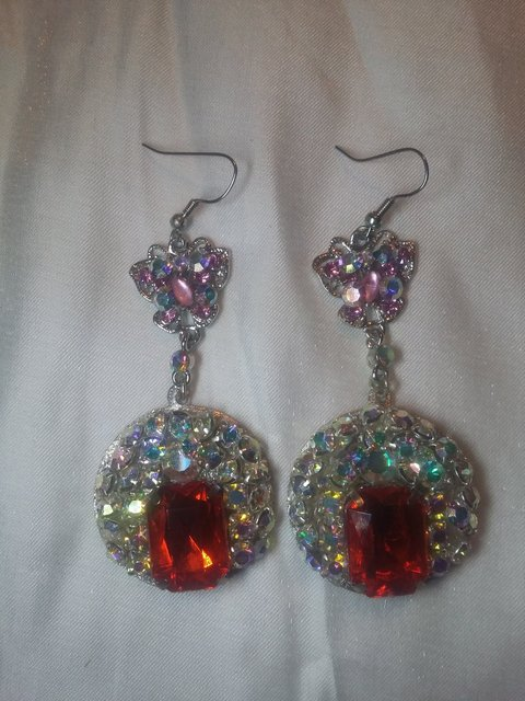 SILVER EARRINGS with clear, pink, ab, and red stones.