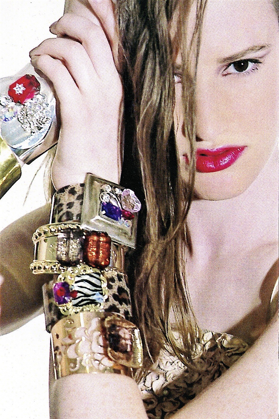 CHANDELIERS CUFFS in multiple colors and styles worn by EMILY.