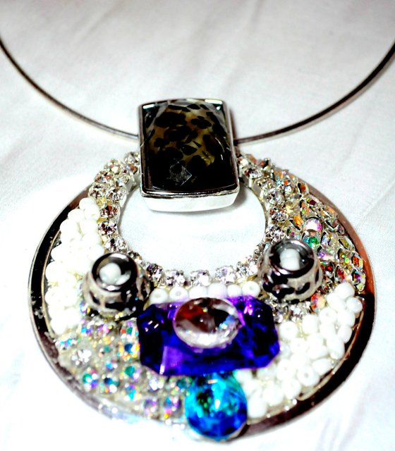 SILVER CHOKER with a combination of colored stones and embellishments.