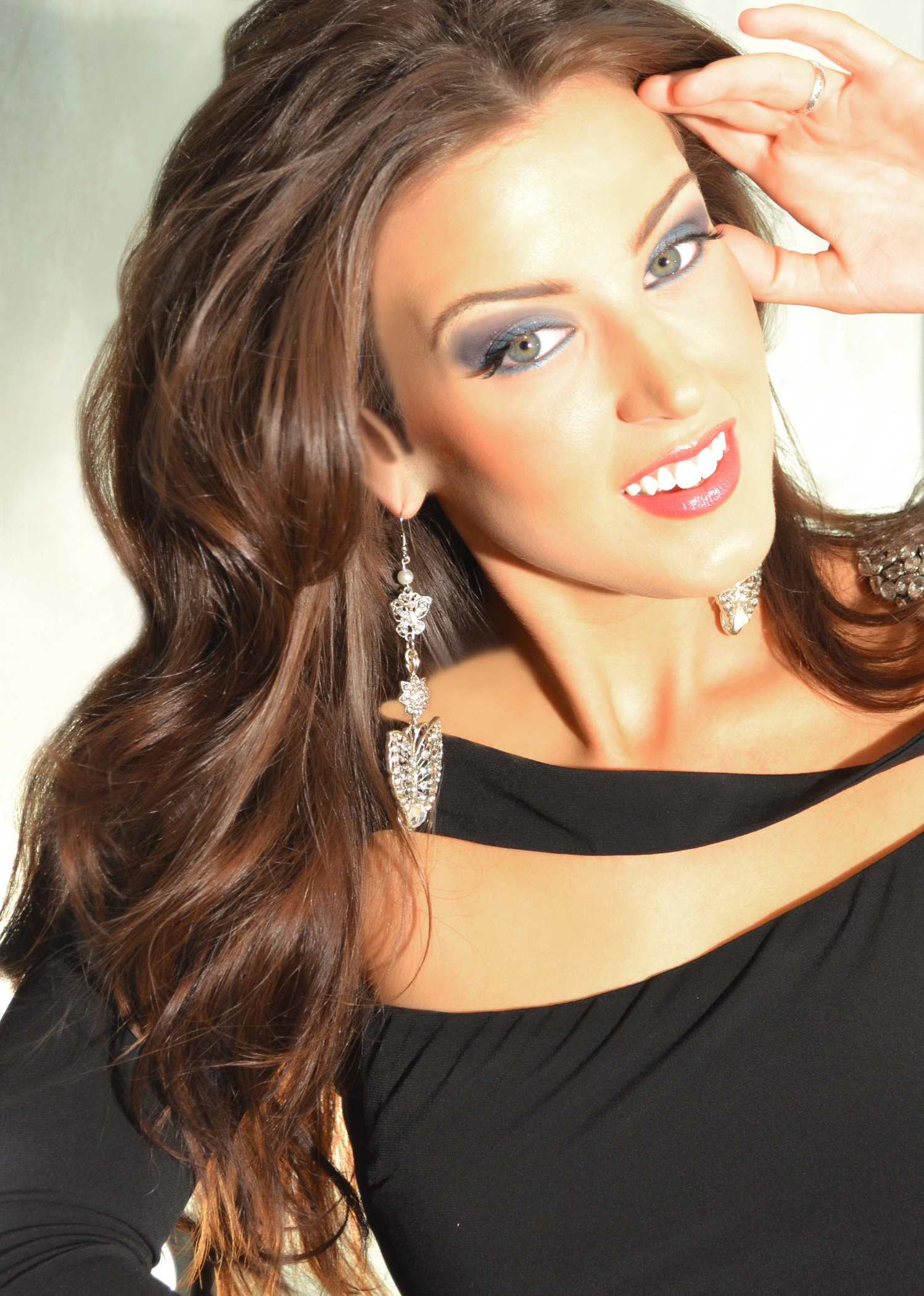 MISS NORTH COAST is wearing 3 layer butterfly silver drops with clear rhinestones.