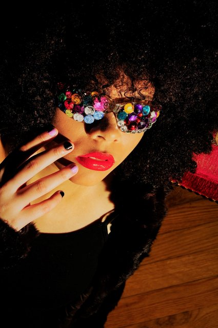 ZHARIA HAS DIOR RED LIPS AND STONED SHADES.