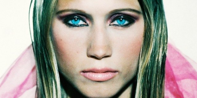 TRACY'S ICE BLUE  EYES ARE DYNAMIC  WITH JET BLACK LINER.
