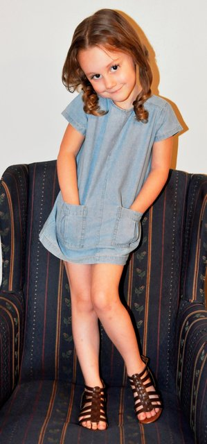 BRAELYN POSES ON A CHAIR FOR FLARE.