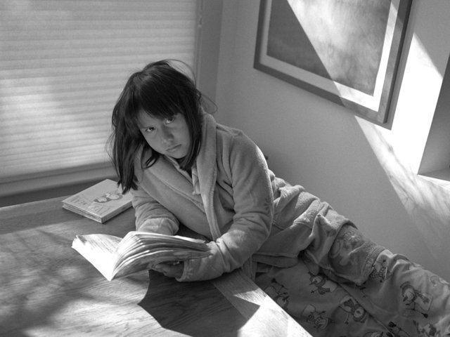 Magdalena Reading on table.jpg