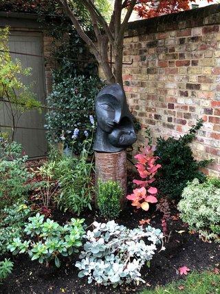 Installing Sculptures In The Garden