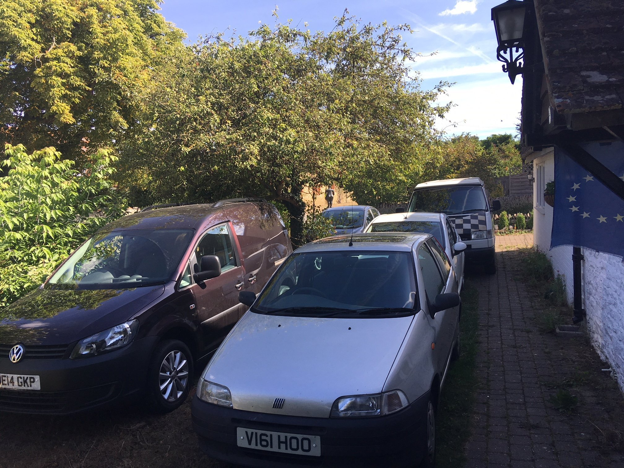 Fourth and fifth car parked ( one a van) side by side