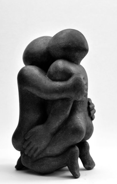 Big Embrace  1995   50 x 30 x 20cm   £2850  Bronze resin cast from a stone carving from 1995,