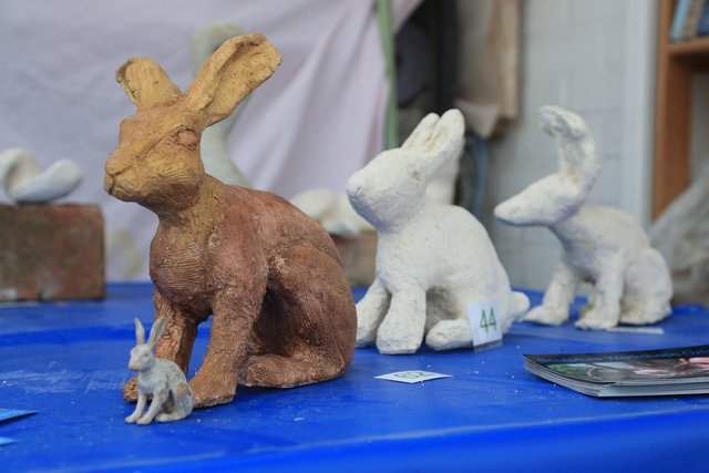 Hares, front one by adult  student , behind by children