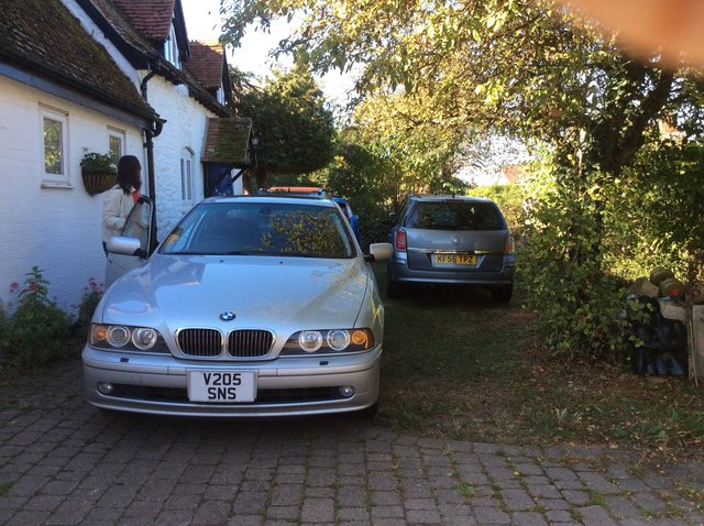 fifth car, beside the tree