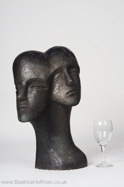 Heads Pulling Apart  2008  50 x 34 x 24cm  Painted Ceramic