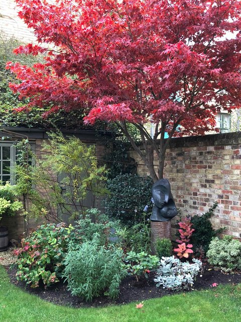 Mother and Child 2 in a small town garden ( Oxford Jericho) November 2018