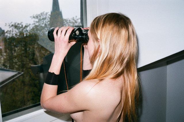 Helga looking at the window, Berlin.jpg
