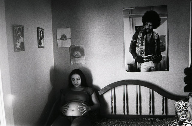 Irina, seven months pregnant in the room where she grew up.