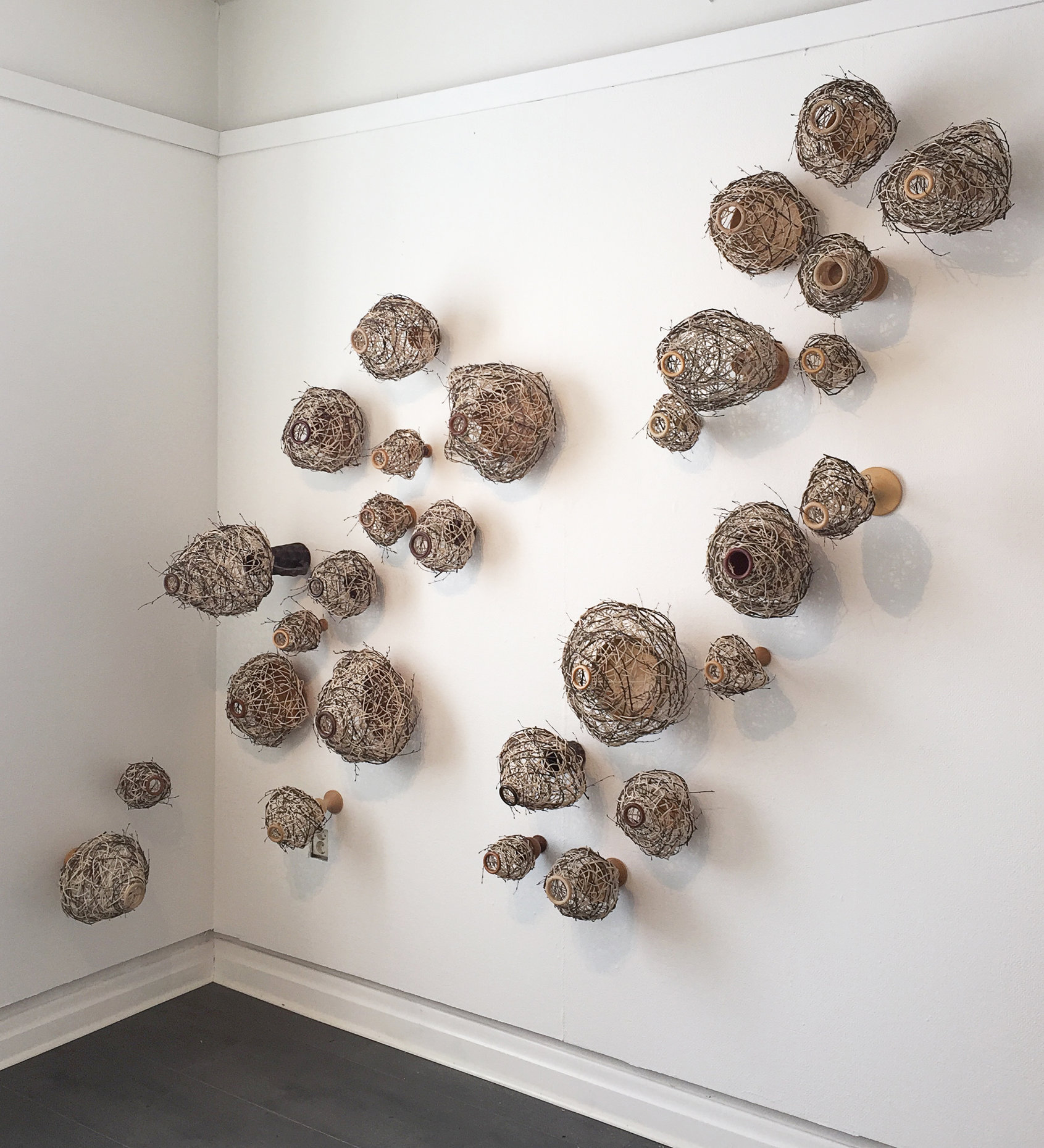 Installation made of wooden objects and rattan. 2015