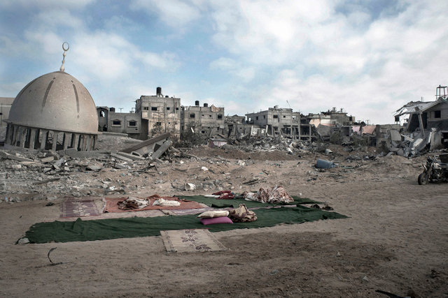 A child sleeping in the middle of a big area destroyed by israeli airstrikes Kuzaa, Gaza Strip