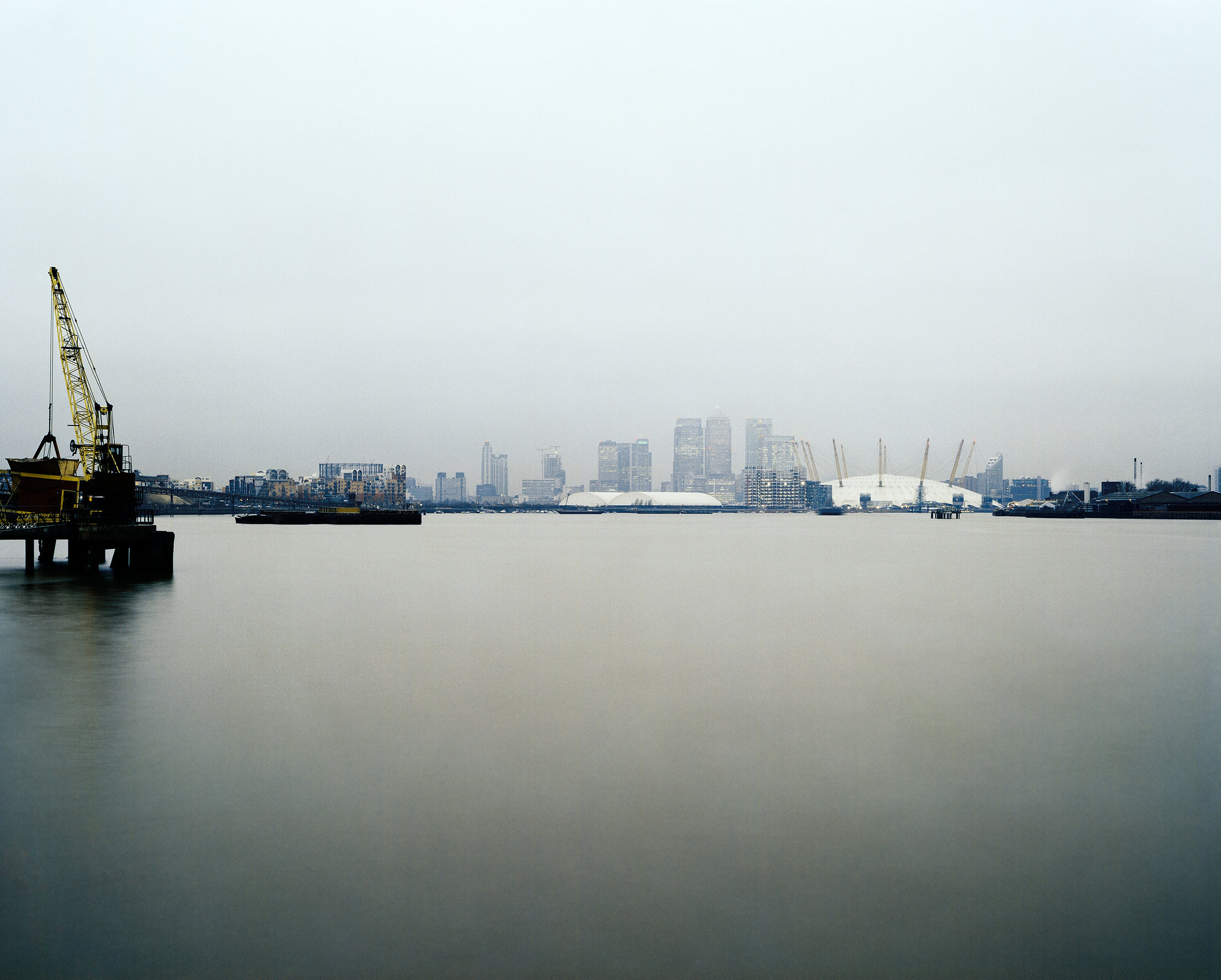 View of The O2 (Millennium Dome), Canary Wharf and the Thames in London.
