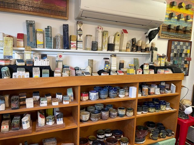 Clay casitas, cups and bowls display